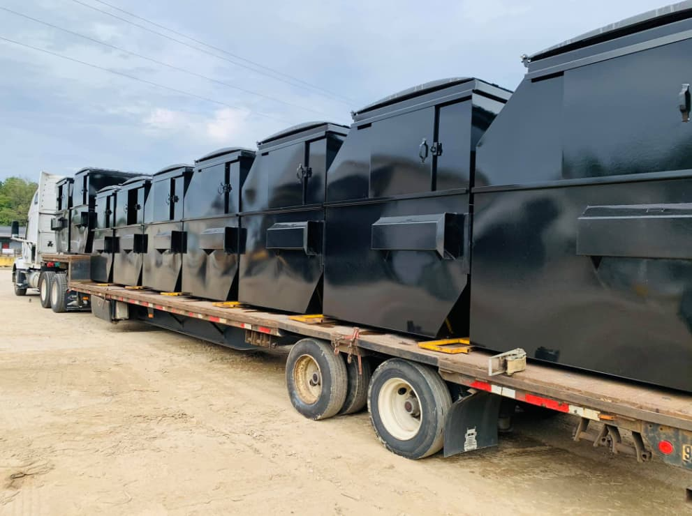 Wall Recycling dumpsters on a truck to be delivered for rentals in the Raleigh NC area